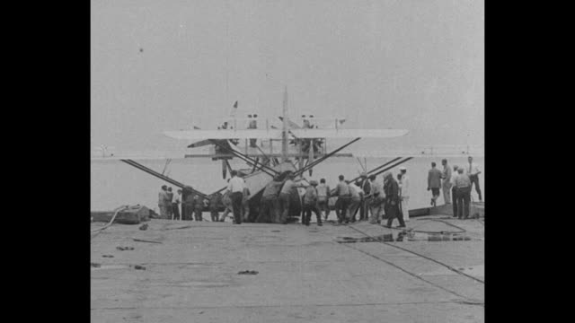 '50Seat Plane Takes the Air Philadelphia Giant German Air Yacht Launched for First US Test Flight' / MLS crowd follows aircraft away from camera on...