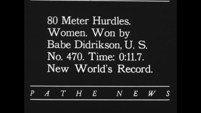 '80 Meter Hurdles Women Won by Babe Didrikson US No 470 Time 0117 New World's Record' / WS gun start audience stands women run leap hurdles / CU...