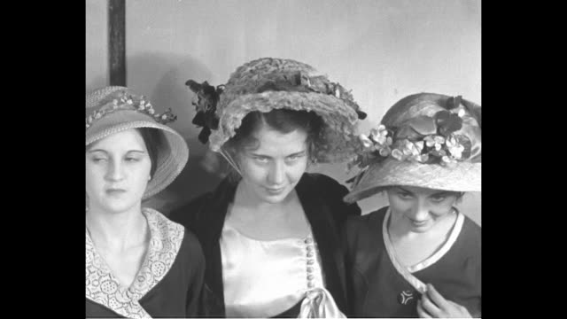 "century of hats! milwaukee--grandpa paid plenty for these! marquette u. co-eds try on 'the latest creations' dating from 1831 onward."" / three co-eds... - inch stock videos & royalty-free footage"