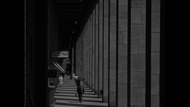 "city of contrasts - stuttgart"" / vs buildings, hilly cityscape of stuttgart / tilt-down shot street scenes with streetcars, pedestrians / police... - rathaus stock-videos und b-roll-filmmaterial"