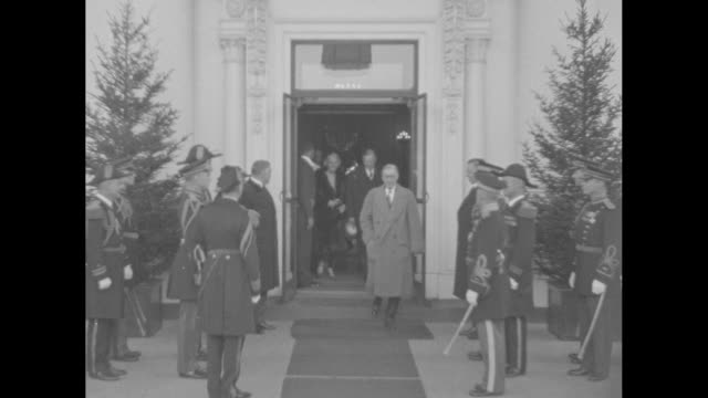 a happy new year to the nation's first citizens / us president herbert hoover and wife lou emerge from white house military officers salute him as... - herbert hoover us president stock videos & royalty-free footage