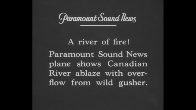 vidéos et rushes de a river of fire paramount sound news plane shows canadian river ablaze with overflow from wild gusher / aerial shot of plume of smoke rising from oil... - oklahoma