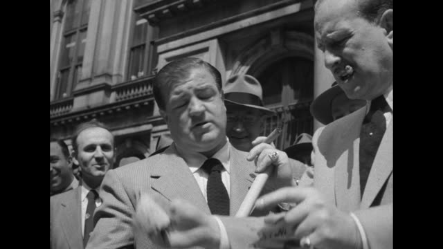 Abbott Costello at 'Beanstalk' Boston Premiere / comedy duo Bud Abbott and Lou Costello clown around with street sweeper brooms and bins on Boston...