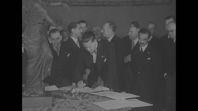 japanese ambassador masaaki hotta signs anti-comintern pact between japan, germany and italy as other diplomats look on from the background / mcu... - east asian ethnicity stock videos & royalty-free footage
