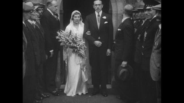 after the ceremony the happy couple leaves / lady may cambridge and husband henry abel smith leave church after wedding / they stand and face camera... - awning stock videos and b-roll footage