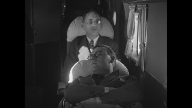 airliner fueling up / vs night of luggage and passengers loading into twa airliner / mcu captain eddie rickenbacker speaks into mouthpiece / airplane... - 航空便点の映像素材/bロール
