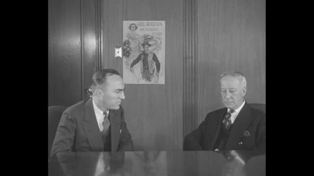 stockvideo's en b-roll-footage met al smith aids will rogers fund / ms aviator eddie rickenbacker and former new york governor al smith sit at table and discuss fund for will rogers... - al smith