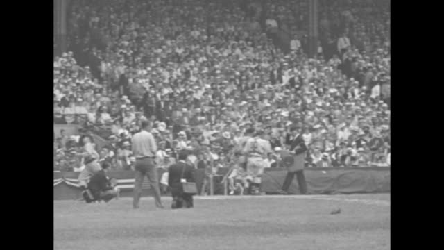 """""""all-star baseball"""" superimposed over cleveland stadium / stands filled with spectators / national league players in dugout / players in dugout /... - frankie vaughan stock videos & royalty-free footage"""
