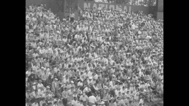 AllStar Game superimposed over crowd in stands / shot of crowd in stands / American League president Will Harridge National League president Warren...