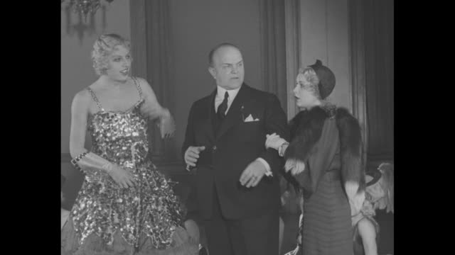 alma mammies / columbia university student james millard in chorus girl outfit sitting in chair as woman applies makeup to him to make him look like... - stockings stock videos & royalty-free footage