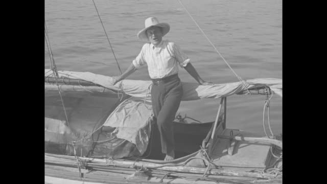 amateur sailor crosses pacific in tiny boat fred rebell of australia ends 8000 mile trip at cabrillo beach calif / fred rebell lowers the sail on his... - sextant stock videos & royalty-free footage