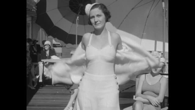"""and now 1933 beach fashions - winter vacationists find less fabric and more freedom in first show at the surf club, miami beach, fla."" /fashion show... - trousers stock videos & royalty-free footage"