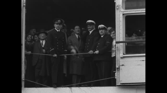 """""""and now 'jimmy' gets a real new york welcome"""" / two shots of former new york mayor jimmy walker and other passengers on board ship as it crosses new... - pier stock videos & royalty-free footage"""