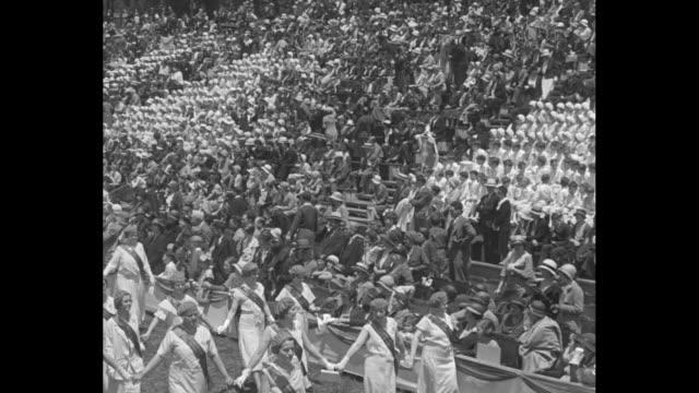 vídeos y material grabado en eventos de stock de archbishop curley celebrates field mass in washington catholics gather in brookland stadium for solemn religious celebration / catholic groups parade... - servicio religioso