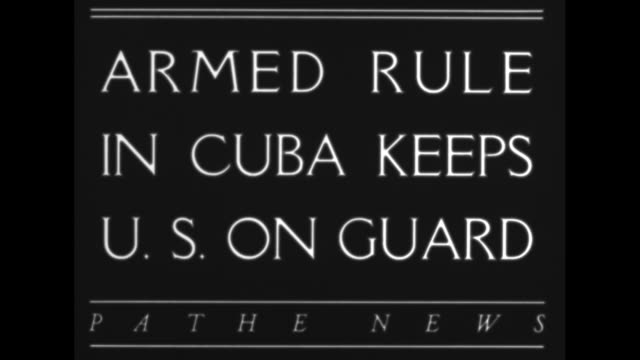 armed rule in cuba keeps us on guard / ws tiltdown ext hotel nacional de cuba to cable cars and pedestrians in street below / palm tree sways in... - sandbag stock videos and b-roll footage