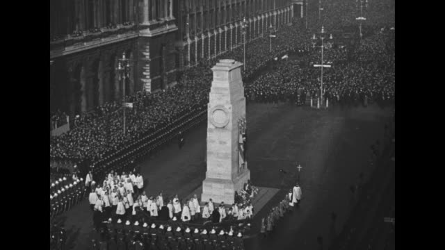 "–armistice day 1931"" / wv cenotaph war memorial and crowd around it as churchmen and clergy walk in file around memorial and take up position on one... - minister clergy stock videos and b-roll footage"