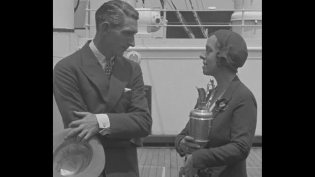 stockvideo's en b-roll-footage met òarmour returns us new yorkamerican pro tommy armour 1931 winner of british open golf tournament and mrs armour return to us june 12 1931ó / standing... - british open