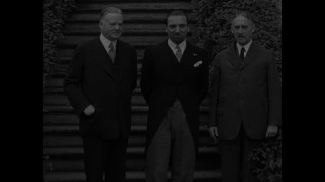 """arriving in washington, grandi meets president hoover and sec'y stimson, as they prepare for eventful conference"" / l-r us president herbert hoover,... - 外交点の映像素材/bロール"