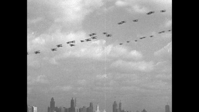at chicago war birds stage thrilling spectacle as they protect the city / about 36 biplanes fly over chicago in formation / various shots biplanes in... - skyscraper stock videos & royalty-free footage