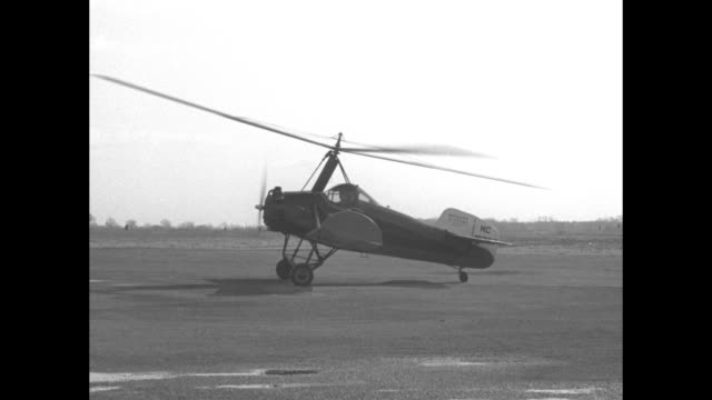 """""""autogiro lands in philadelphia street as taxi for sailor - chief officer story uses craft for reaching the waterfront in time to join his ship"""" /... - surrounding stock videos & royalty-free footage"""