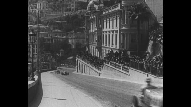 autos race thru monte carlo streets at mileaminute twentythree drivers dash along boulevards in monaco grand prix / vs numerous shots of speeding... - monaco stock-videos und b-roll-filmmaterial