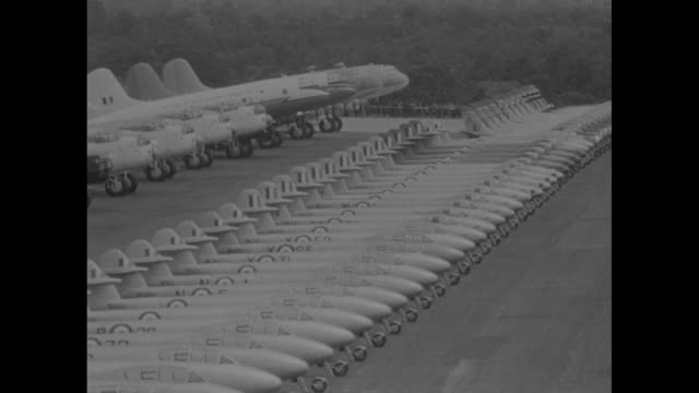 aviation news / title coronation flypast superimposed over a large grouping of aircraft / queen elizabeth and prince philip seated in the rear of an... - military aeroplane stock videos & royalty-free footage