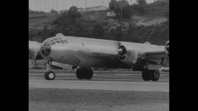 B29 The Superfortress That Bombed Japan / new B29 bomber taxiing and turning/ bomber takes off flying past camera / shot from plane of bomber in...