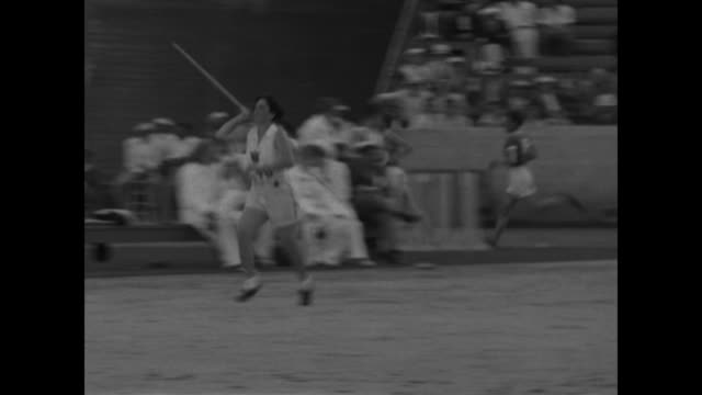 vídeos de stock e filmes b-roll de babe didrikson no 470 sets women's record for javelin throw distance 143 ft 4 in / american competitor throws javelin camera follows it to landing... - 1930