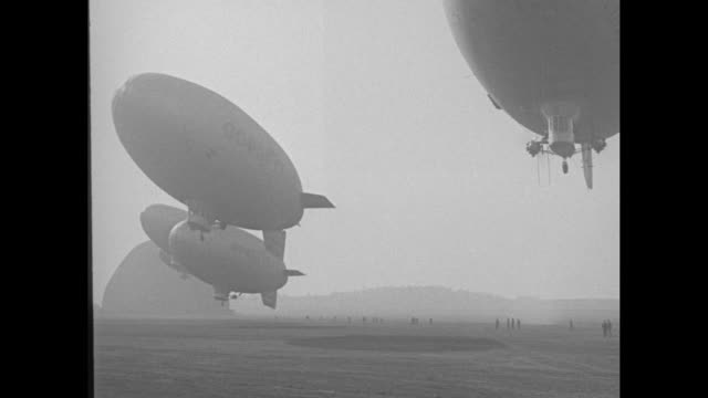 baby blimps fill air in first parade akron o goodyear fleet of tiny airships take off in mass formation trip in clouds / row of airships taking off /... - pattern stock videos & royalty-free footage