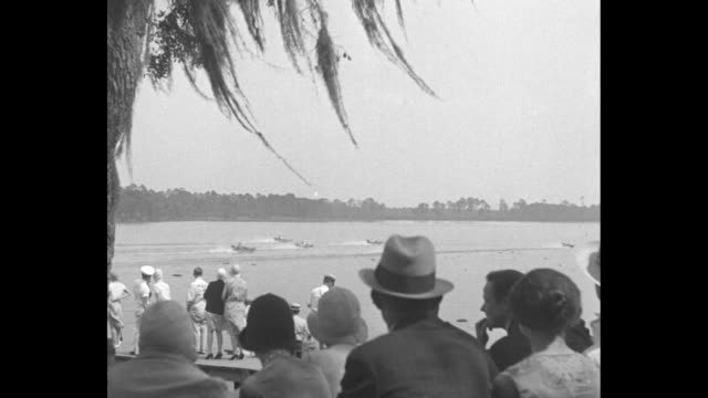 """title card: """"baby outboards try for record, jacksonville, fl - tiny motorboats skim scenic course and top speed in seminole club race""""/ vs seen... - epiphyte stock videos & royalty-free footage"""