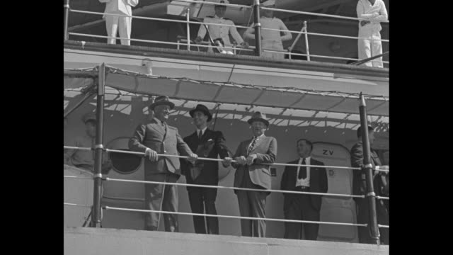 """""""back on the job again"""" over black then superimposed over president franklin d. roosevelt waving / vs cruiser uss houston coming toward camera,... - sailor stock videos & royalty-free footage"""