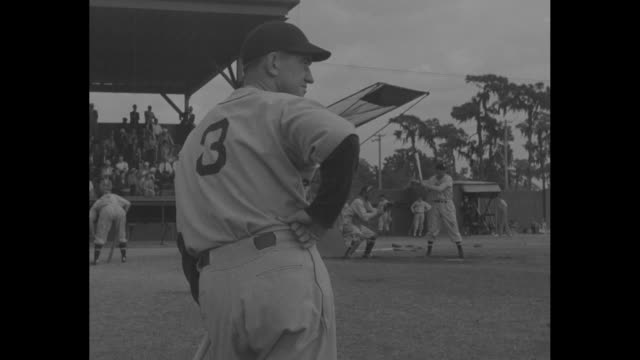 Baseball League Aims To Hold That Tiger /various shots Detroit Tigers warm up during spring training / med close up Tigers manager Mickey Cochrane...