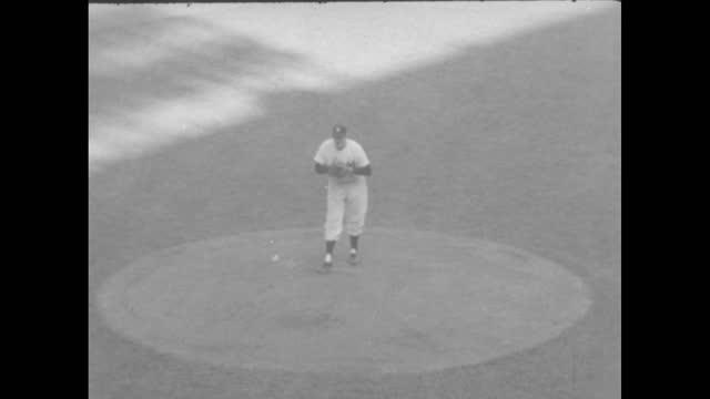 """""""baseball"""" / vo marty glickman continues """"the year in sports,"""" featuring don larsen pitching a perfect game in game 5 of the 1956 world series... - 囲む点の映像素材/bロール"""