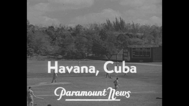 Batter Up Big League Stars Get Set / Title card Havana Cuba superimposed over New York Giants baseball team in spring training / close up on Bill...