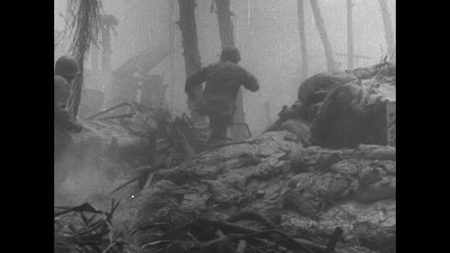 """""""battle of tarawa"""" / title card: """"three extraordinary combat pictures, taken during the last few hours on tarawa . . . the toughest, bloodiest action... - shooting a weapon stock videos & royalty-free footage"""