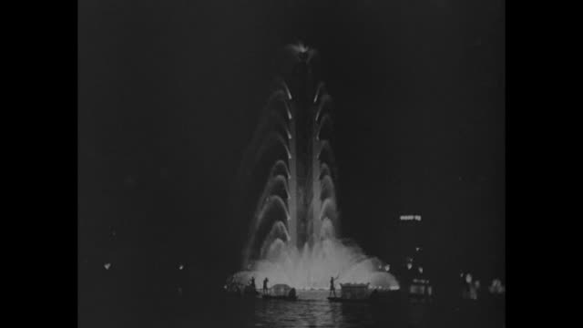 vídeos de stock e filmes b-roll de beauty 'fit for a queen' illuminated fountains furnish spectacular night display / vs illuminated fountains at night some with small gondolas passing... - 1931