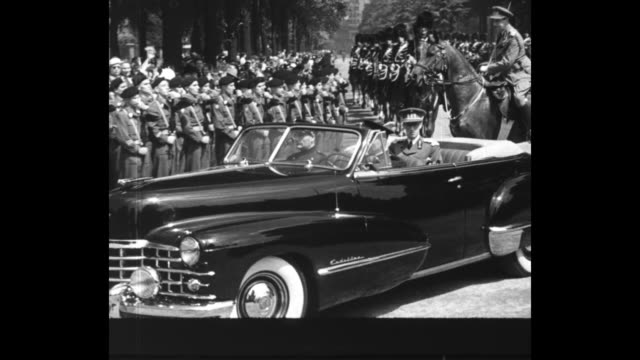 òbelgium crowns new kingó superimposed over prince baudouin riding in an opentop car / prince baudouin rides in opentop car saluting cheering crowd /... - bow riding stock videos & royalty-free footage