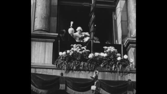 belgium mourns queen [clip footage compiled when queen astrid died] / prince leopold and princess astrid wave from balcony / closer view of prince... - fluggastbrücke stock-videos und b-roll-filmmaterial