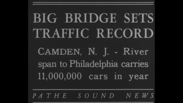 vídeos de stock e filmes b-roll de big bridge sets traffic record camden nj river span to philadelphia carries 11000 cars in a year / elevated view of the road seen from a spire of the... - spire