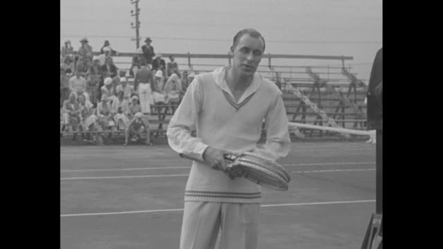 bill tilden makes tennis his racketmiami flafamous champion begins practise matches as a professional / tilden on court holding rackets and talking... - tennis racket stock videos & royalty-free footage