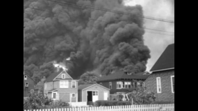 blasts flames rip refinery for 2 days superimposed over huge cloud of black smoke and police cars and police officers in street as refinery burns /... - fire hose stock videos and b-roll footage
