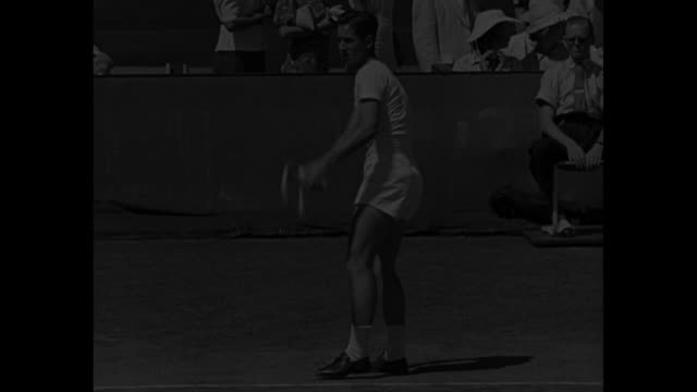 """""""bobby riggs reaches top in u.s. tennis"""" / title: """"rye, n.y."""" superimposed over tennis player bobby riggs walking away from camera, with player frank... - スポーツの判定員点の映像素材/bロール"""