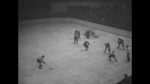 """boston bruins in action"" superimposed over hockey game / boston bruins hockey team photo / coach art ross of boston bruins / vs eddie shore skating... - team photo stock videos & royalty-free footage"