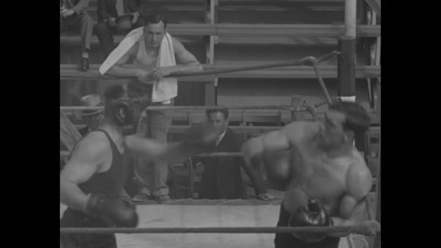 boxer carnera lumbers upmiami flaman mountain of pugilism works out for his battle with heavyweight maloney / carnera and another boxer sparring man... - primo carnera stock videos and b-roll footage