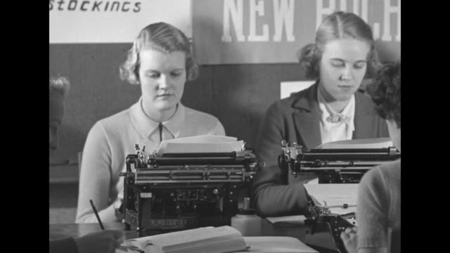 """boycott - coeds shun silk hose for cotton"" / students sitting at typewriters on table typing for school newspaper, signs on wall saying ""discard... - stockings stock videos & royalty-free footage"