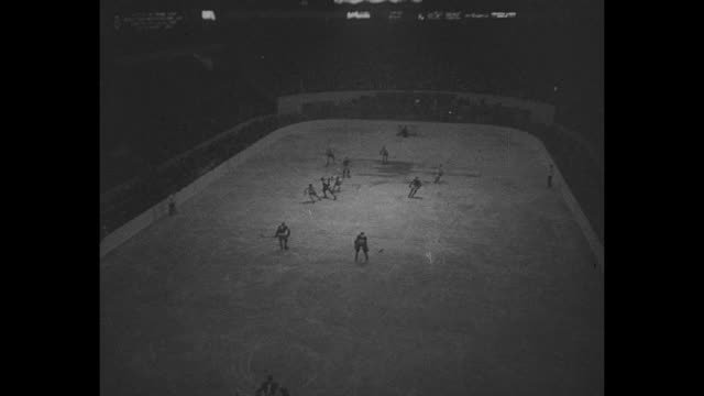 breaking the ice toronto hockey season glides in brilliant play marks clash as canadiens world ice champs battle maple leafs / before game band... - maple leaf stock videos and b-roll footage
