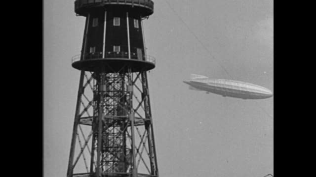 britain dismantles r100 ending tests of giant airships dirigible which flew atlantic to canada is scrapped at cardington by government / r100 in sky... - speichen stock-videos und b-roll-filmmaterial
