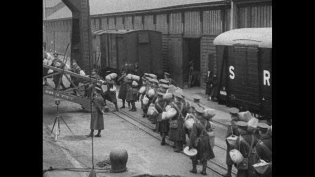 british troops sail for india famous middlesex regiment embarks at southampton for service in the east / soldiers carrying duffel bags walking in... - 1932 stock videos & royalty-free footage