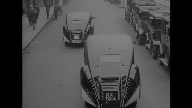 builds automobile shaped like r100 london england sir dennistoun burney airship designer evolves new type streamline for cars / two burney cars... - driving stock videos & royalty-free footage