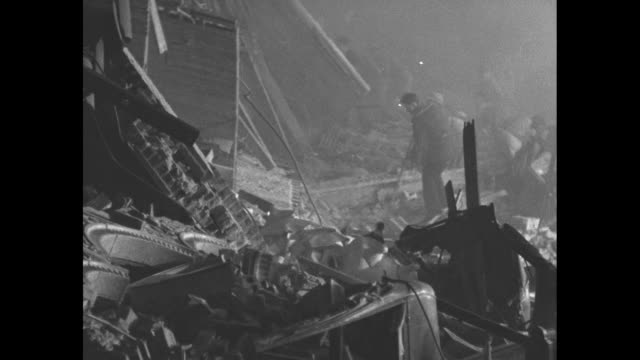 """vidéos et rushes de dissolve to title card: """"made during night of terror, while shocks were killing scores and injuring thousands, these unusual pictures show havoc in... - âge humain"""